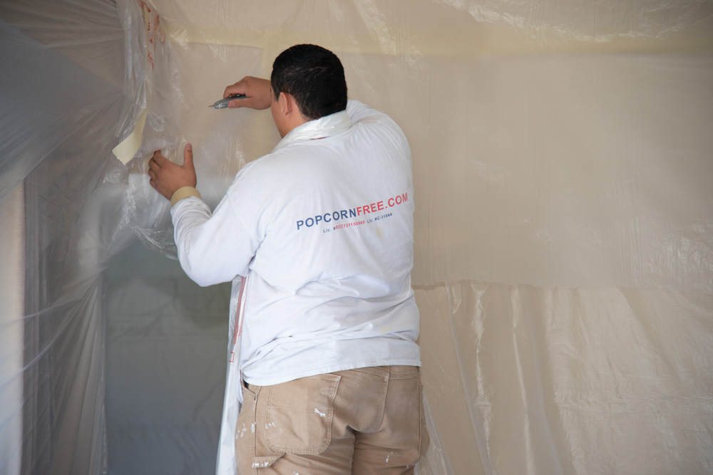 Installing Drop Cloth in Bedroom